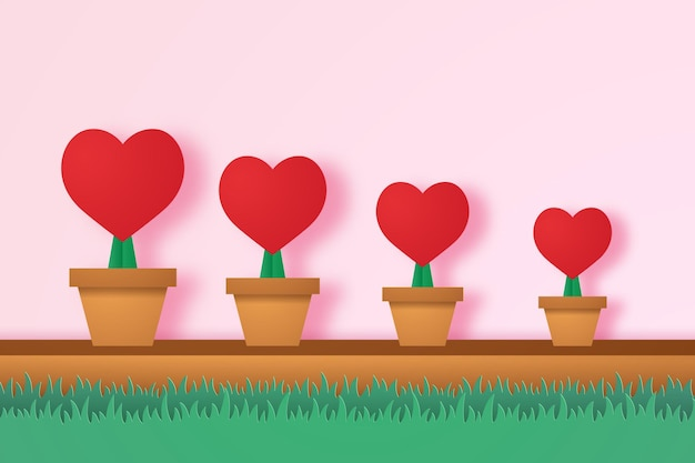 Cuore rosso in vaso con erba in stile arte della carta