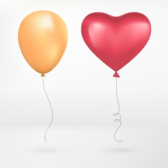 Cuori rossi, realistico volo giallo e rosso palloncino a forma di cuore.