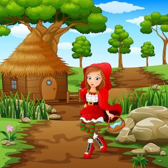 La ragazza con cappuccio rossa si trova nel villaggio della foresta
