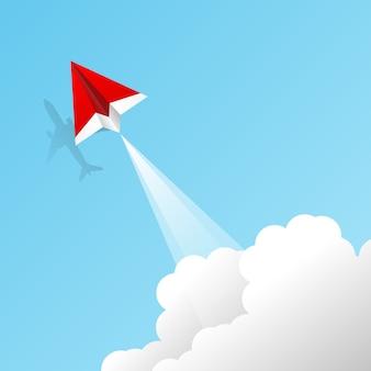L'aereo di carta rosso vola con l'ombra del concetto di aeroplano