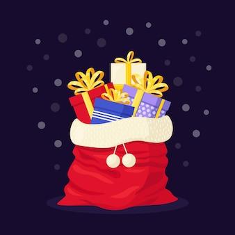 Borsa rossa santa con elementi regalo per la celebrazione delle vacanze di natale. sacco di babbo natale pieno di pacchetti di regali. buon natale e felice anno nuovo