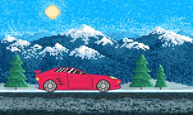 Automobile sportiva rossa e paesaggio della montagna
