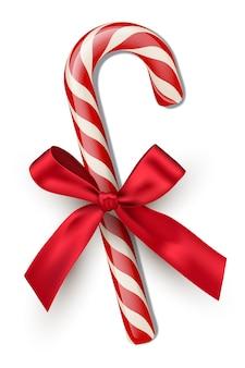 Bastoncino di zucchero a strisce rosse con fiocco isolato su sfondo bianco elemento di design di natale e capodanno
