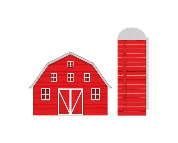 Fienile in legno rosso e silo agricolo per lo stoccaggio del grano