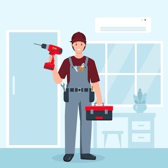 Ripara uomo in uniforme con trapano e cassetta degli attrezzi da lavoro in camera