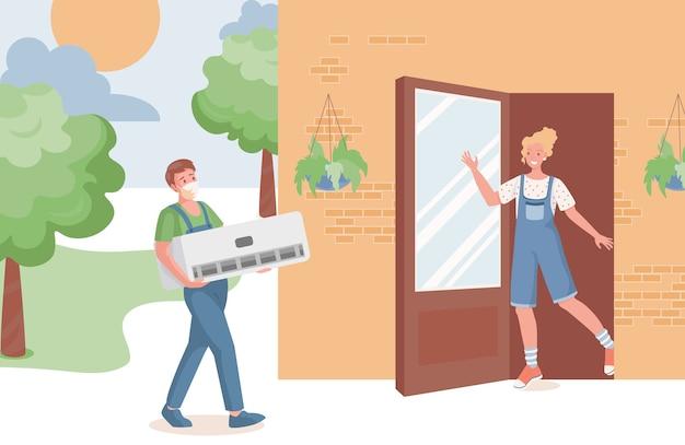 Il professionista del servizio di riparazione porta il condizionatore d'aria nella casa di campagna
