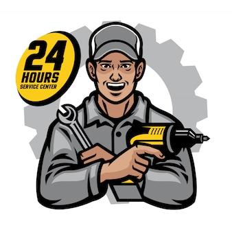 Ripari il lavoratore che sorride tenendo la chiave e trapano