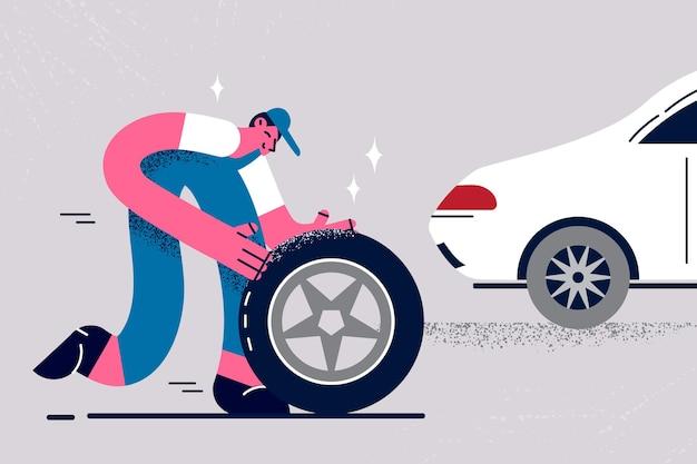 Riparatore e cambiare il concetto di ruote per auto. giovane lavoratore in uniforme e berretto che cambia ruota per l'auto bianca del cliente nell'illustrazione vettoriale del salone