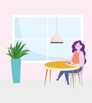 Distanziamento sociale da ristorante, donna che mangia frutta da sola a tavola, prevenzione coronavirus