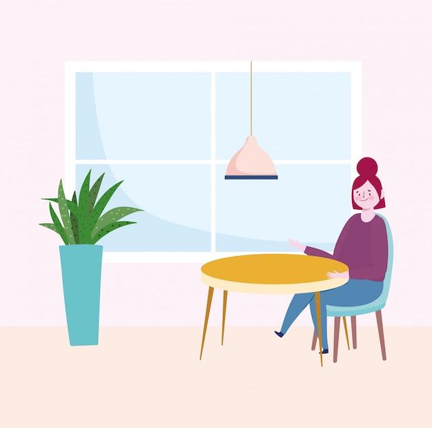 Ristorante sociale di distanza, donna seduta da sola, mantenere una distanza di sicurezza, prevenzione coronavirus