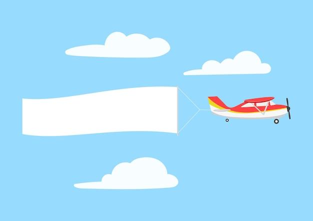 Aereo retrò con banner a nastro nel cielo sopra le nuvole.