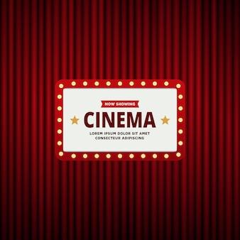 Cornice del cinema retrò e sfondo della tenda rossa