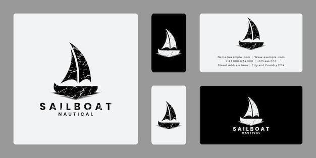 Vettore di design del logo della barca a vela in stile retrò