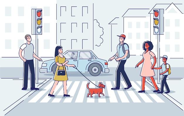 Attraversamento pedonale della strada con un gruppo di persone che si affrettano.