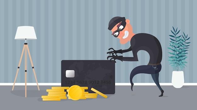 Il rapinatore ruba una carta di credito. il ladro sta cercando di rubare una carta di credito.