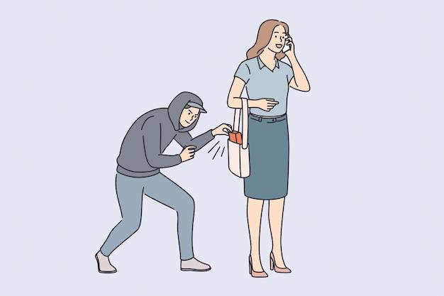 Concetto di rapina, ladro e criminalità. giovane ladro ladro in cappuccio che cerca di rubare oggetti femminili dalla sua borsa all'aperto illustrazione vettoriale