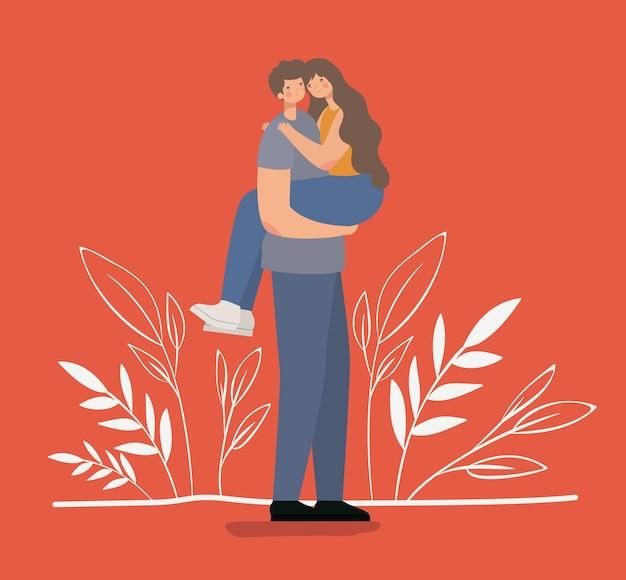 Coppie romantiche che abbracciano e che sollevano la ragazza