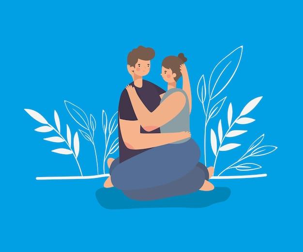 Coppie romantiche che si siedono e che abbracciano