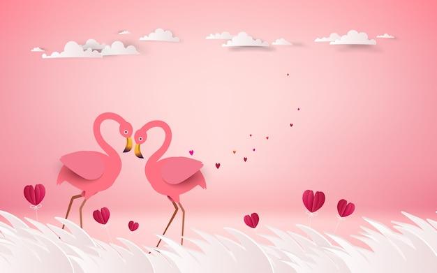 Romantici uccelli fenicotteri rosa si uniscono alle teste per creare un cuore