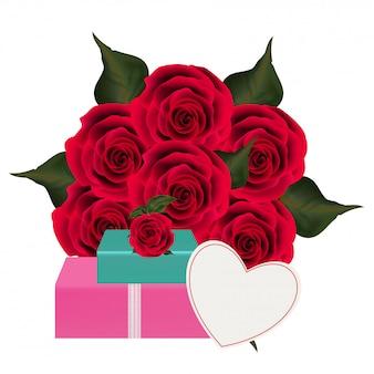 Bouquet di fiori di rosa con scatole regalo.