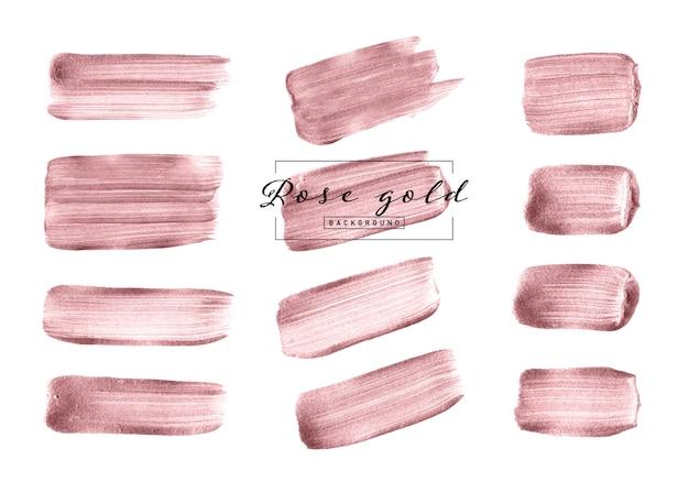 Insieme disegnato a mano della spazzola dell'oro di rosa isolato su fondo bianco