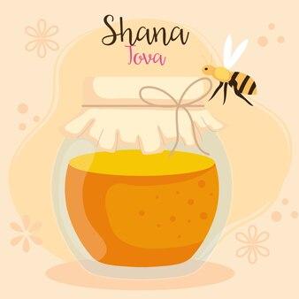 Celebrazione di rosh hashanah, capodanno ebraico, con bottiglia di miele e ape che volano