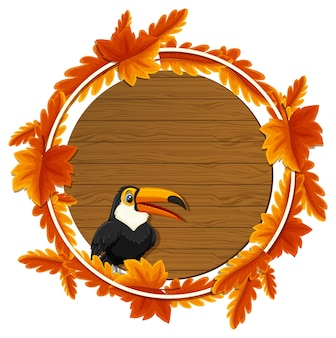 Modello rotondo dell'insegna delle foglie di autunno con un personaggio dei cartoni animati del tucano