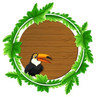 Modello di banner di foglie verdi rotonde con un personaggio dei cartoni animati di tucano