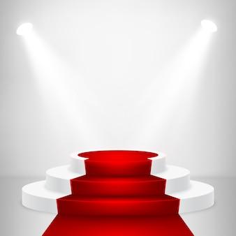 Podio rotondo con luce. scena festosa del podio con tappeto rosso