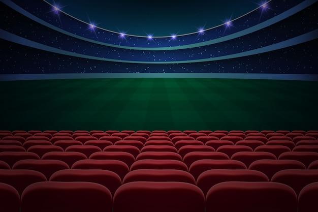 File di sedili rossi su stadio di calcio. sfondo di calcio