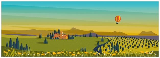 Campagna rurale in primavera o in estate. collina verde con vigneto con mongolfiera. agricoltura in primavera o in estate.