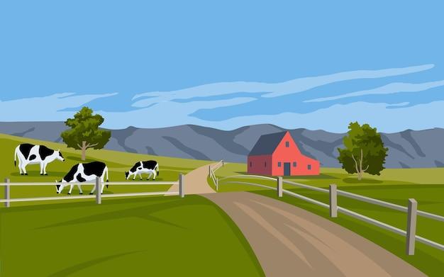 Paesaggio rurale con fienile e bestiame al pascolo