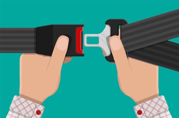 Cintura di sicurezza in mano.