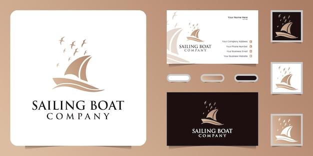 Ispirazione per il design del logo della silhouette di una barca a vela e di un uccello volante