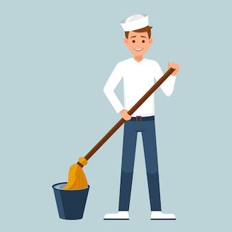 Il marinaio che immerge il mop in un secchio d'acqua