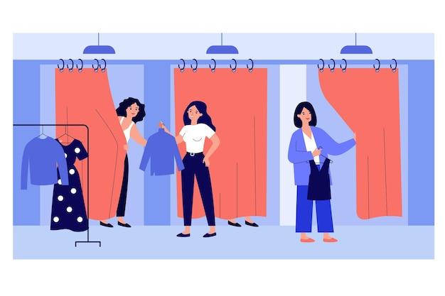 Assistente di vendita che aiuta i clienti nel camerino