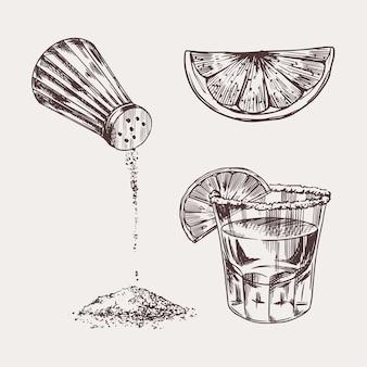 Sale e un bicchierino di tequila e lime