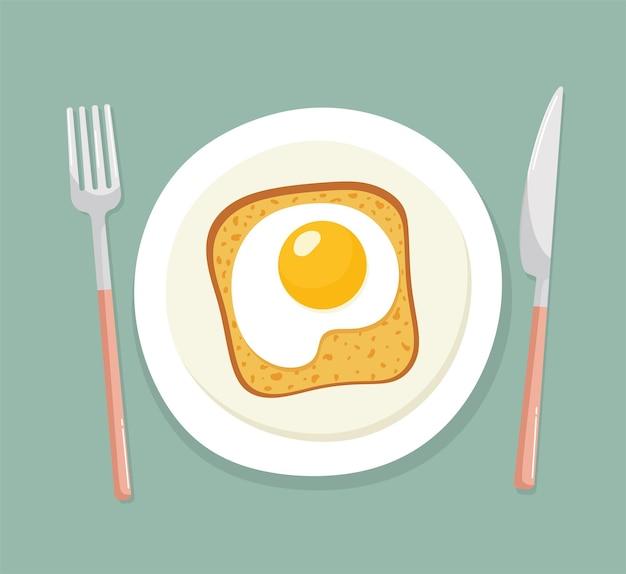 Panino con una fetta di pane e un uovo fritto su un piatto