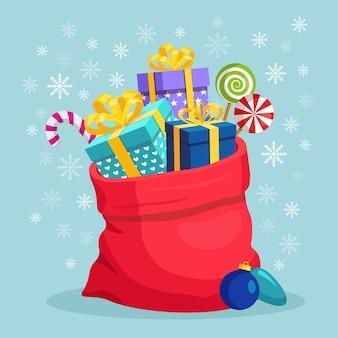 Borsa rossa di babbo natale con scatola regalo. sacco di natale pieno di regali pacchetto