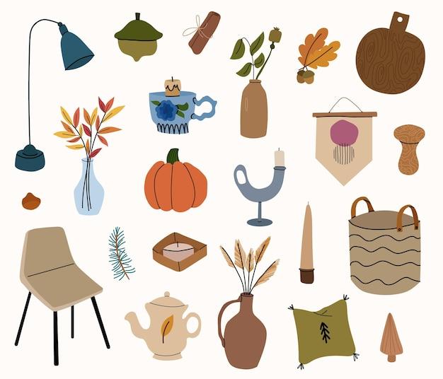 Elementi di design autunnali scandinavi. mobili, candele, decorazioni per la casa. illustrazione disegnata a mano del fumetto di vettore.