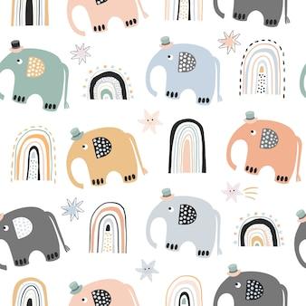 Modello senza cuciture bambino scandinavo con arcobaleni elefante carino Vettore Premium