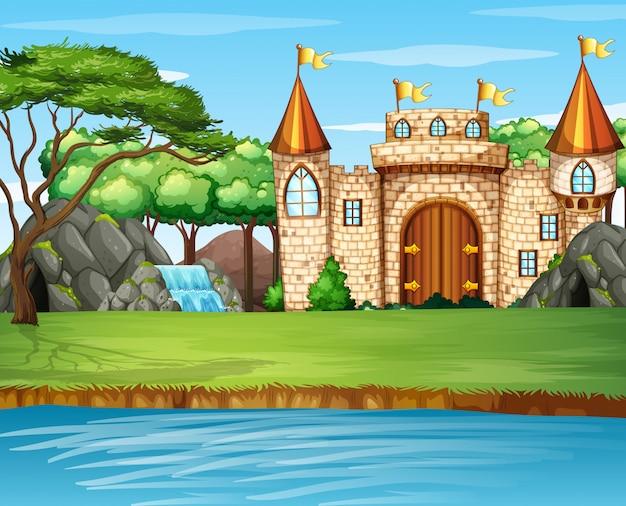 Scena con grande castello vicino alla cascata