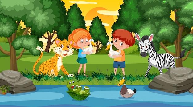 Scena con bambini felici e animali nel parco