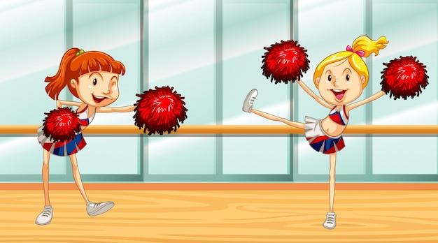 Scena con due cheerleader nella stanza