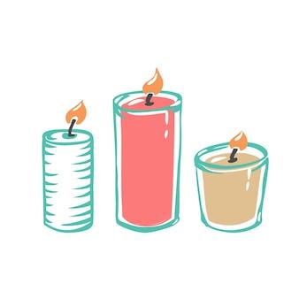 Le candele profumate per l'aromaterapia sono isolate su uno sfondo bianco hygge home decoration