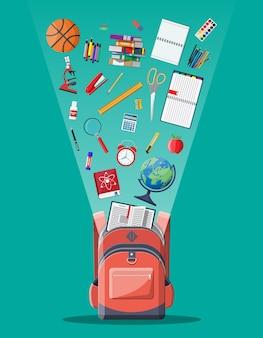 Zaino scuola con libri, vernice, globo, palla, mela, calcolatrice, penna, matita, sveglia righello microscopio.