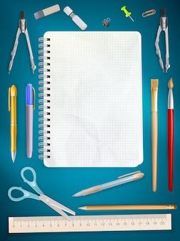 Articoli per ufficio della scuola su fondo blu.