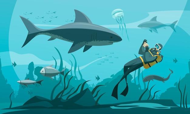 Subacqueo che fotografa uno squalo
