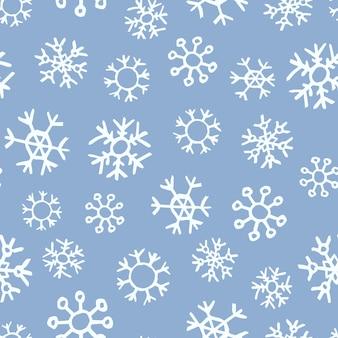 Fondo senza cuciture dei fiocchi di neve disegnati a mano. illustrazione di vettore.