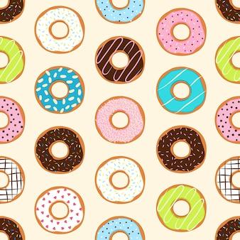 Sfondo senza soluzione di continuità con ciambelle colorate, illustrazione vettoriale
